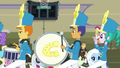 Drummer, bass drummer, and piccolo player EG3.png