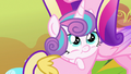 Flurry Heart cradled in Princess Cadance's hooves S7E22.png