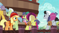 Incredibly long line of porter ponies S6E22.png
