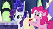 Pinkie holding blank scroll and quill S9E13