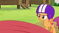 Scootaloo looking at the overturned kayak S7E21
