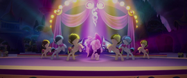 Songbird and backup dancers performing on stage MLPTM
