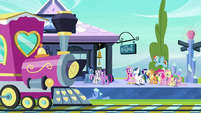 The main cast walking to the train S6E2