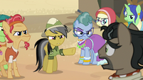 Daring Do and villagers glaring at Dr. Caballeron S7E18