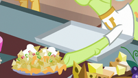 Granny Smith picking up plate of nachos S8E5