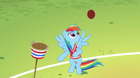 Rainbow Dash juggles a ball with her wing S6E18