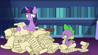 Twilight Sparkle in a pile of lesson scrolls S7E1