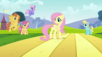Fluttershy looking back toward Rainbow Dash S2E22