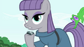 Maud holding sedimentary rock S4E18.png