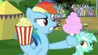 Rainbow holding popcorn and cotton candy S8E20