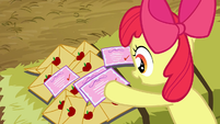 Apple Bloom sorts through the invitations S3E8