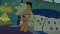 Applejack turns off her nightstand lamp S6E15.png