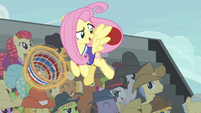 Fluttershy catches Braeburn's goal shot S6E18