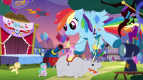 Large balloon shaped like Rainbow Dash S4E12