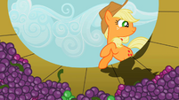 Applejack about to enter a container filled with grapes S2E05