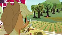 Applejack sees Apple Bloom by a tree S8E12