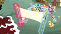 Birthday banner being raised S4E12.png