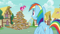 Pinkie Pie standing on a pyramid of pies S7E23