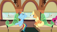 Rainbow and Applejack relaxing in their train car S6E18