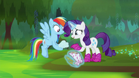 Rarity looks at Rainbow Dash's tiny cloud S8E17
