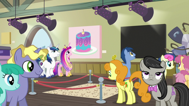 File:Shining Armor and Cadance look at cake painting S7E3.png