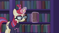 Moon Dancer taking a book off the shelf S5E12.png
