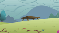 Picnic table in the distance S1E08