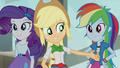 Applejack pointing toward bass guitar EG2.png
