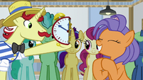 Flam holding half of a clock S8E16