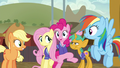 Fluttershy and Pinkie surrounded by friends S6E18.png