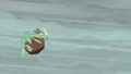 Green wrinkly dragon hit by boulder S6E5.png