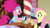 Pinkie gives Fluttershy her candy bag S5E21