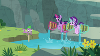Twilight and Starlight pour water in the creek S7E5