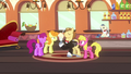 Con Mane entertaining in train car S2E24.png