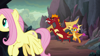 Fluttershy, Garble, and Smolder follow Spike S9E9