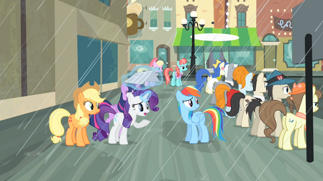 File:Rarity covering herself with newpaper S04E08.png
