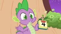 Spike holding a calendar S2E20