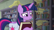 Twilight holding her copy of Perfection S9E5