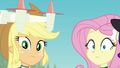 AJ and Fluttershy looking shocked at Sunset EGFF.png
