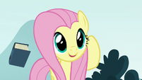Fluttershy tossing the EEA guidebook away S8E2