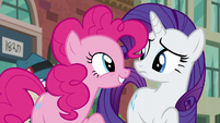 Pinkie Pie finishes spelling PSSSD and smiling at Rarity S6E3