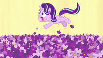 Starlight falling upward through field of flowers S7E10