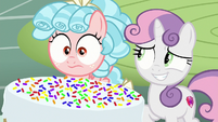 Sweetie Belle grins nervously at Cozy Glow S8E12