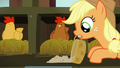Applejack spreads chicken feed in front of brown chicken S6E10.png