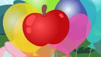 Balloon shaped like an apple S4E09