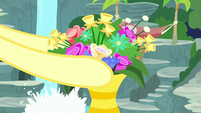 Fluttershy putting flowers in a vase S8E18
