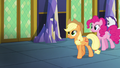 Applejack, Pinkie, and Rarity walking in the castle hallway S5E03.png