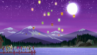 Campers watch their lanterns float up into the sky EG4