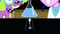 Chemicals boiling over a bunsen burner SS14.png