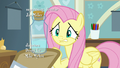 Fluttershy nervously looking at the bottle S7E20.png